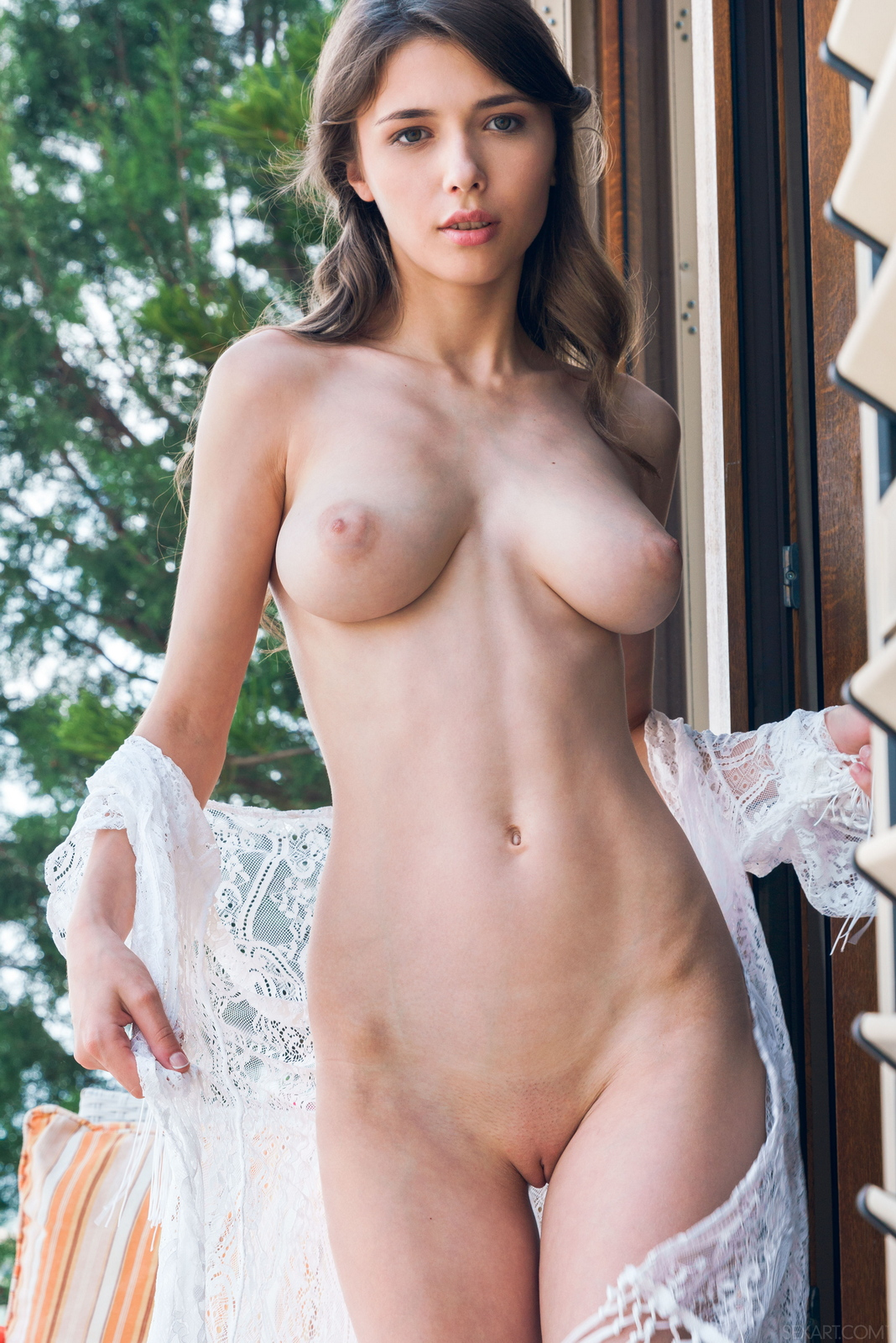 mila-azul-balcony-naked-boobs-slim-sexart-17