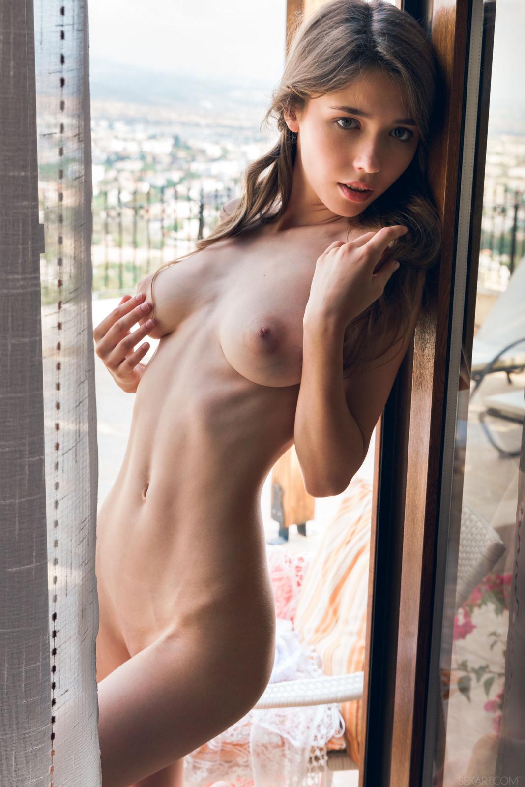 mila-azul-balcony-naked-boobs-slim-sexart-43