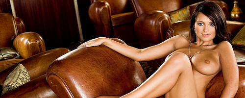 Nikki Mitchell on leather couch