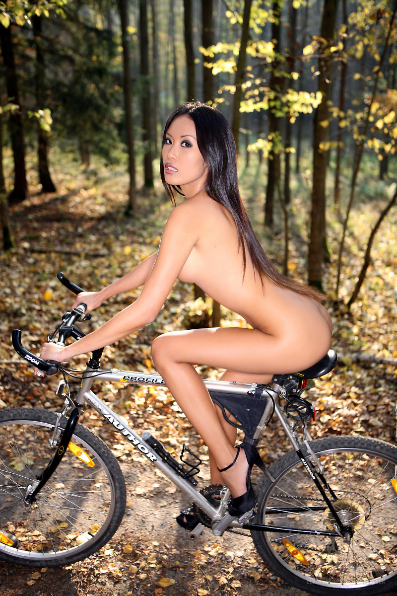 Naked on a bike