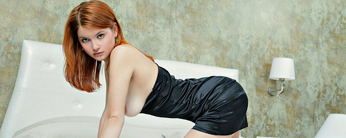 Redhead Violla on bed