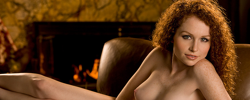 Scarlett Keegan on leather armchair