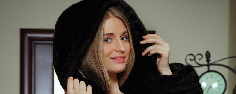 Sheela in black fur coat