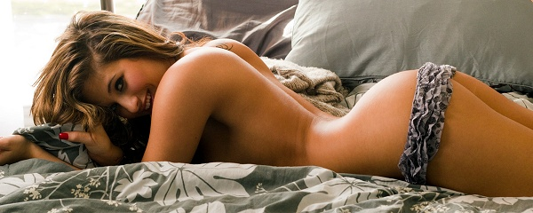 Skylar Hart naked on bed