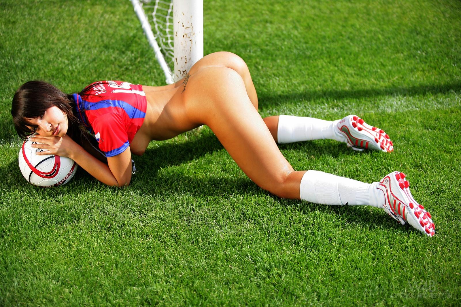 Nude women playing football