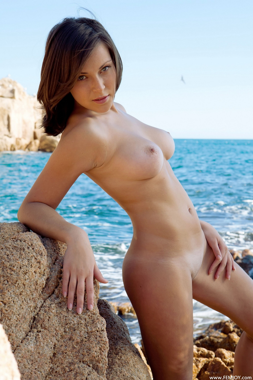 sophia-h-seaside-naked-boobs-rocks-femjoy-12