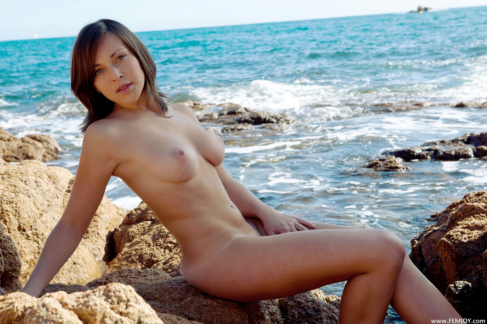 sophia-h-seaside-naked-boobs-rocks-femjoy-35