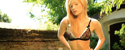 Sweet blond Mia in black stockings