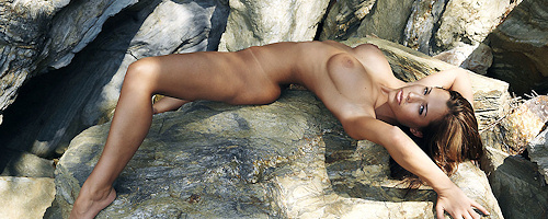 Tonya Tyler lying on the rocks