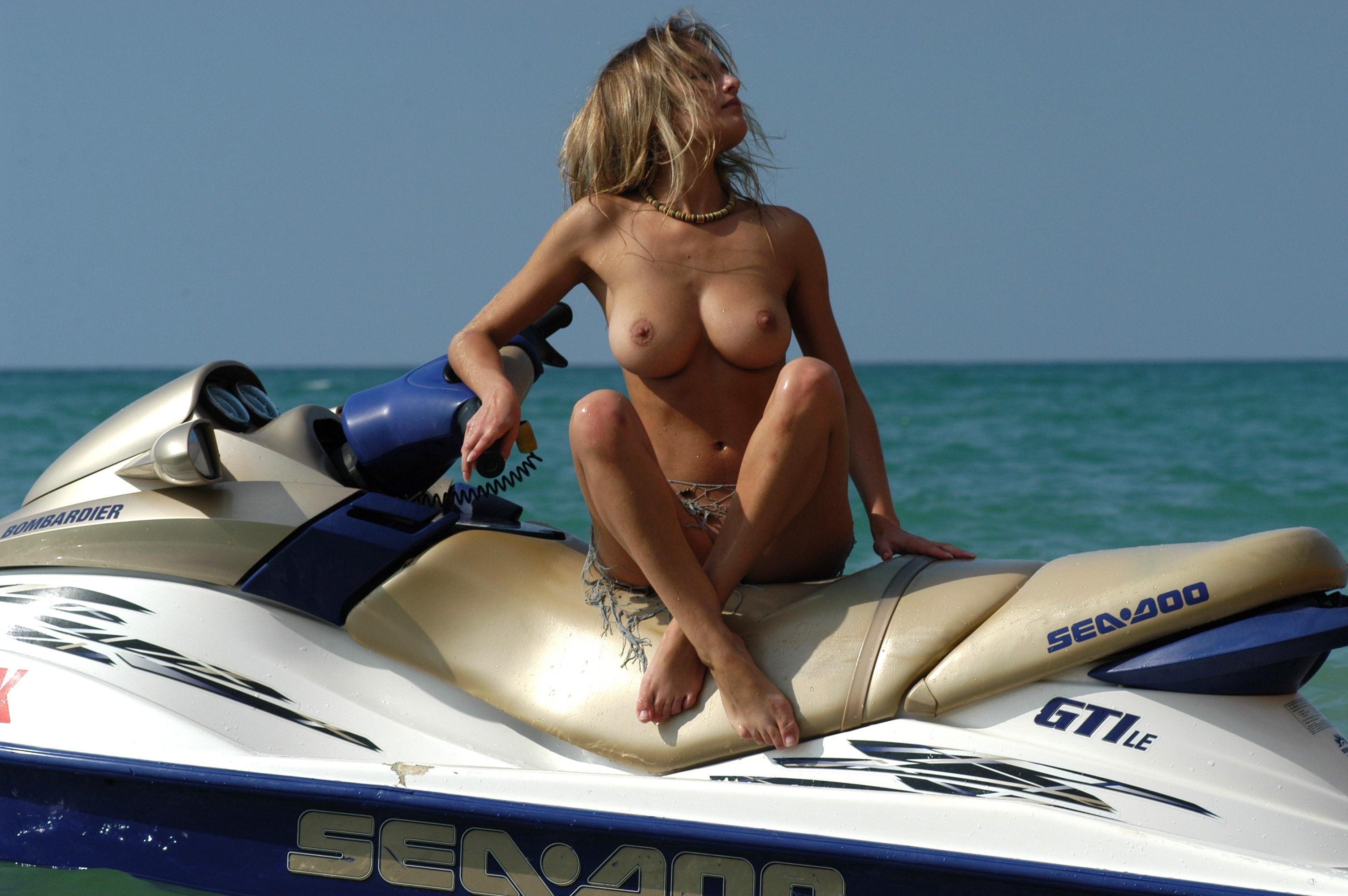 Naked on jet ski