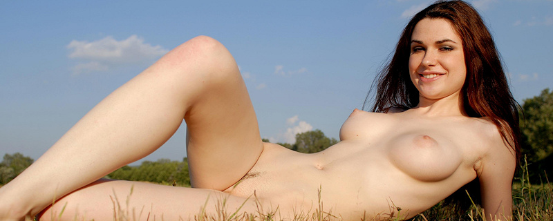 Valda naked on the meadow