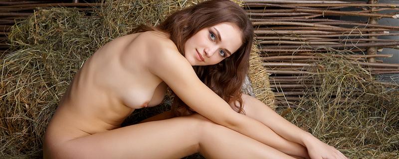 Zlatka naked on the hay
