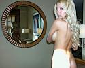 Hot blond in bedroom