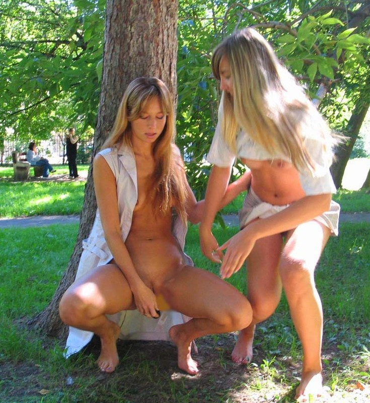 Two girls nude in park
